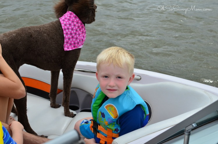 child in a boat with a dog on Lake Granbury