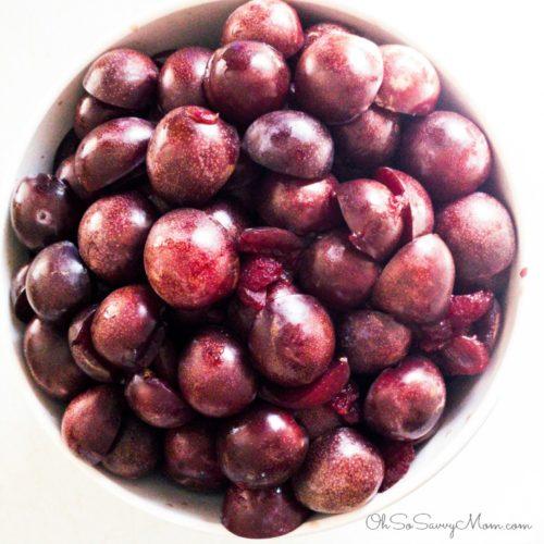 Preparing plums to make spiced plum jam