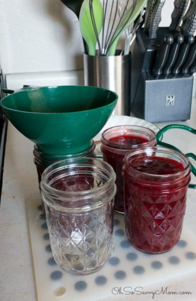 Ladle the plum jam into jam jars